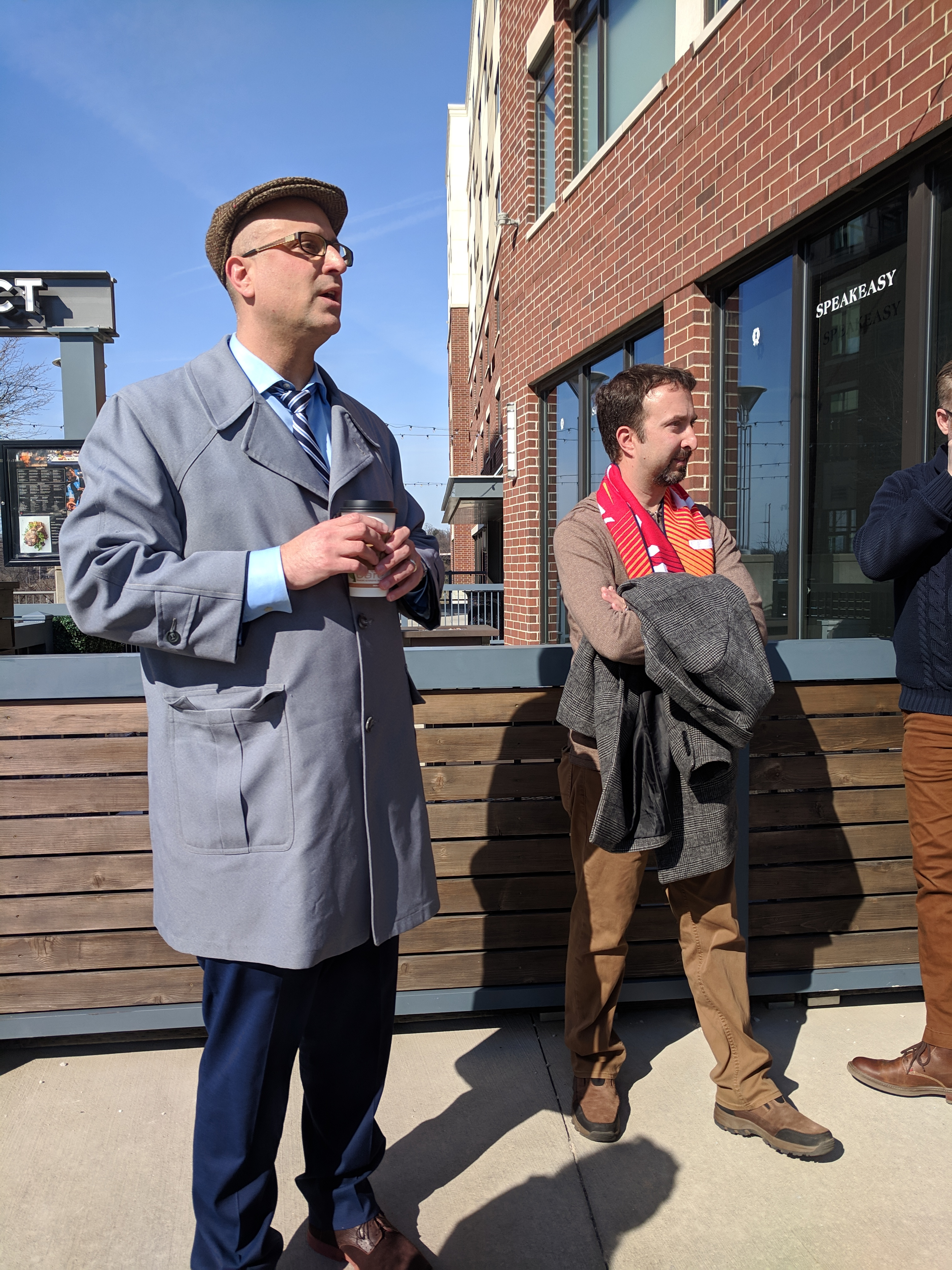 Jason Segedy, director of planning and urban development at the City of Akron, speaks to community of practice participants outside an Akron building.