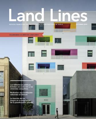 La portada de la edición de octubre de 2019 de Land Lines muestra Independence Branch Library and Apartments en Chicago, un moderno edificio de desarrollo de uso mixto blanco con ventanas coloridas que combina una biblioteca pública con viviendas asequibles.