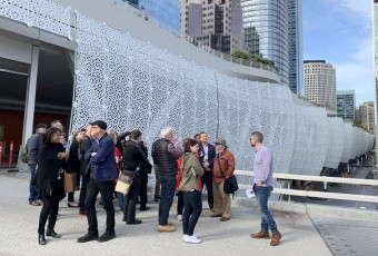 A group of city planners stands outside of the Transbay Transit Center in San Francisco.