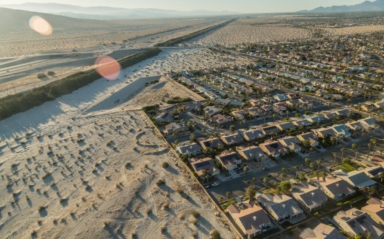 An aerial shot of rows of houses in the Coachella Valley.