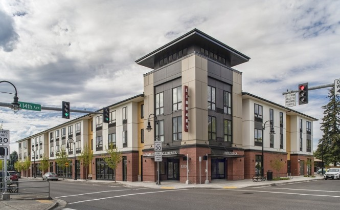 A mixed-used development sits at an intersection in Oregon. The first floor is a library. The other floors are affordable senior housing.