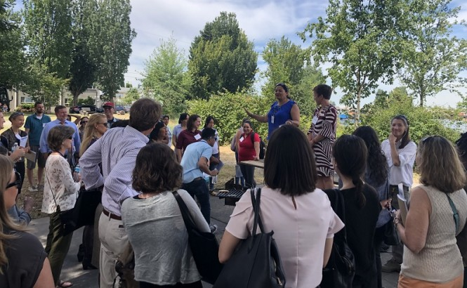 Paulina Lopez speaks to attendees of the Grantmakers in Health Conference in June as part of a tour of the South Park neighborhood.