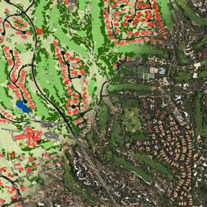 Image shows a high resolution satellite image of a residential area in Tucson, Arizona. Half of the image is overlaid with red to indicate buildings, black to indicate roads, blue to indicate water, and various greens to indicate land and vegetation. The other half of the map looks like a traditional satellite image that shows the landscape as a photograph from very high above.