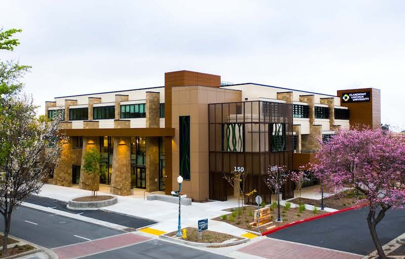 Image of CLU headquarters, a several story building at the corner of an intersection.