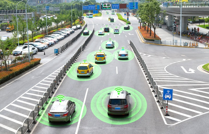 Autonomous self-driving cars on a metro city road.