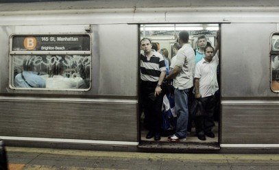 A  crowded subway car with open doors.